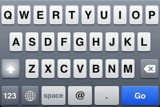 Teclado del iPhone para escribir una dirección de correo electrónico.